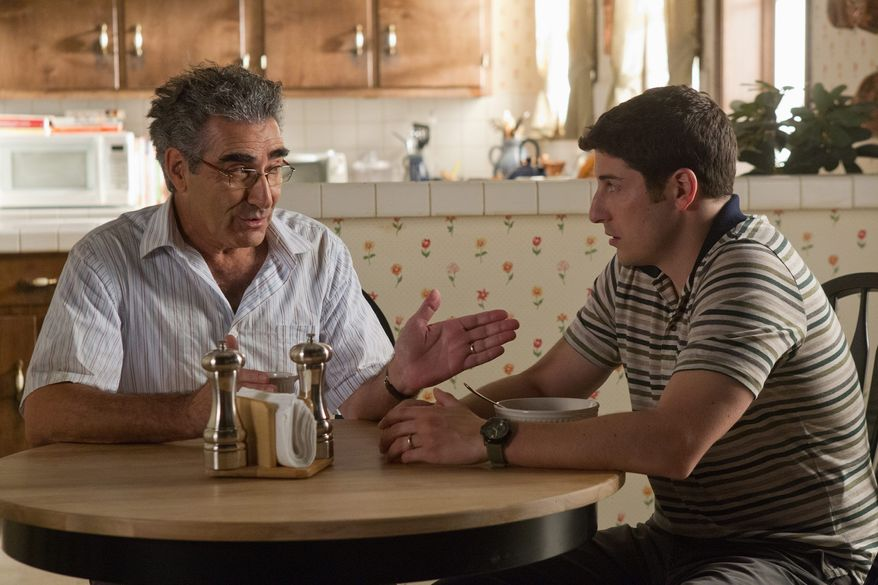 "Eugene Levy (left) is back as Jason Biggs' father in ""American Reunion,"" but in the latest sequel in the ""American Pie"" franchise they seem like a pair of ventriloquist dummies talking among themselves. (Universal Pictures via Associated Press)"