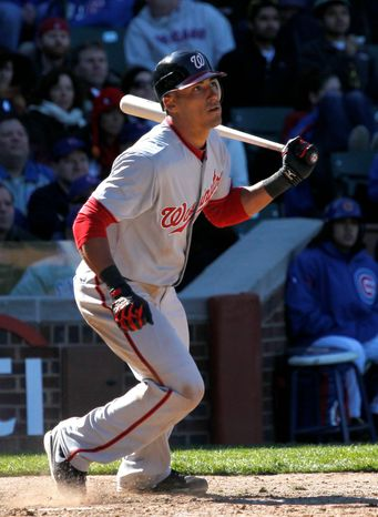 Shortstop Ian Desmond follows his RBI single to right off Chicago reliever Carlos Marmol, scoring pinch runner Brett Carroll with the decisive run in the ninth. Washington won 2-1 at Wrigley Field. (Associated Press)