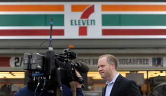 Stephen Martino, director of the Maryland Lottery, outside the Baltimore County 7-Eleven store where the record-breaking $656 million Mega Millions jackpot was sold. (Associated Press)