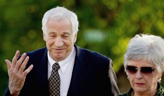 Jerry Sandusky, a former Penn State University assistant football coach charged with sexually abusing boys, is accompanied by wife Dottie as he arrives Thursday at the Centre County Courthouse in Bellefonte, Pa. (Associated Press)