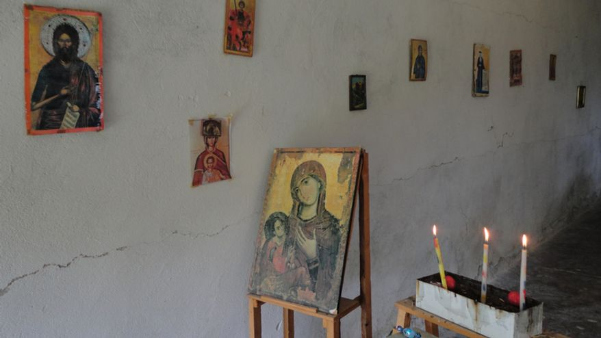 The original icons at the Church of St. Martin in Joronisht, Shpati, were destroyed during the communist regime and have been replaced with cheap copies. (Eckehard Pistrick/Special to The Washington Times)