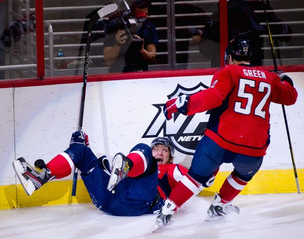 Washington Capitals defenseman Mike Green (52) celebrates as Alex Ovechkin (8) scores in the second period to make it 2-0 against Florida Panthers at Verizon Center in Washington, D.C., Thursday, April 5, 2012. (Andrew Harnik/The Washington Times)