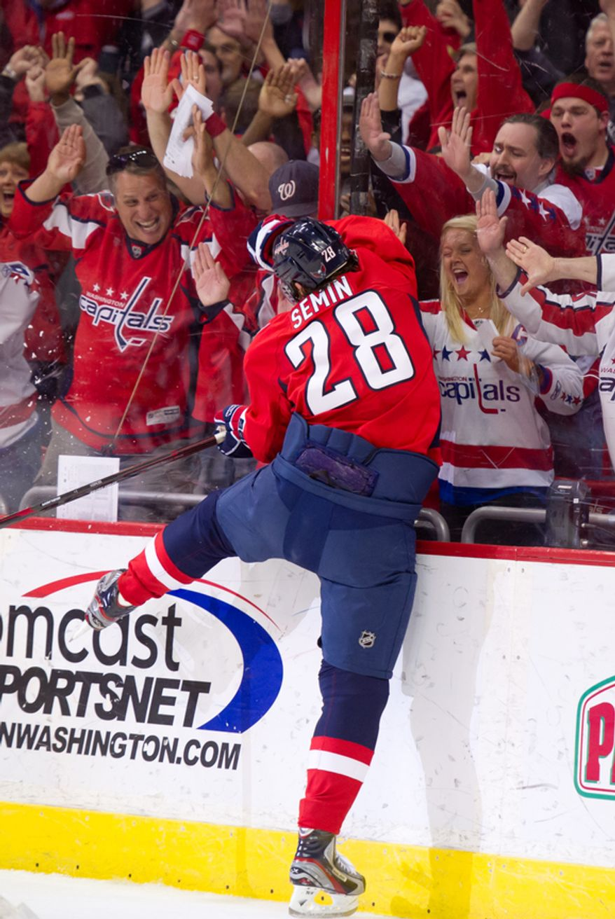 Washington Capitals left wing Alexander Semin (28) slams into the glass after scoring late in the third period to bring the score to 4-2 as the Washington Capitals take on the Florida Panthers in National Hockey League hockey at the Verizon Center, Washington, D.C., Thursday, April 5, 2012. (Andrew Harnik/The Washington Times)