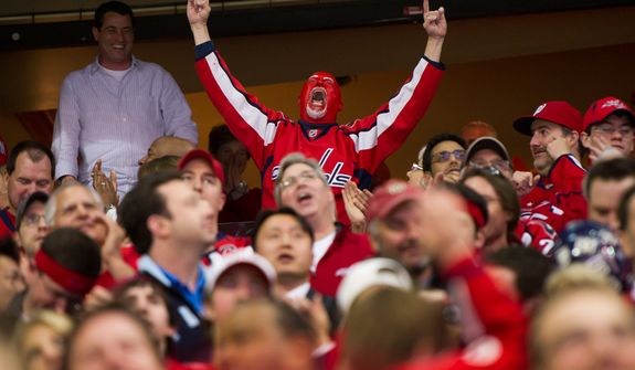 A fan celebrates as Washington Capitals left wing Alexander Semin (28) scores late in the third period to bring the score to 4-2 as the Washington Capitals take on the Florida Panthers in National Hockey League hockey at the Verizon Center, Washington, D.C., Thursday, April 5, 2012. (Andrew Harnik/The Washington Times)