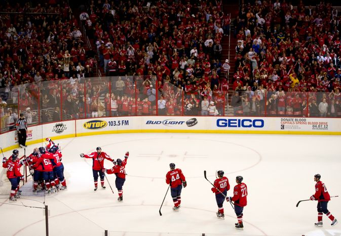 The Washington Capitals celebrate their 4-2 victory over the Florida Panthers in National Hockey League hockey at the Verizon Center, Washington, D.C., Thursday, April 5, 2012. (Andrew Harnik/The Washington Times)