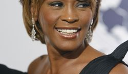 ** FILE ** In this Oct. 28, 2006, file photo, musician Whitney Houston arrives at the 17th Carousel of Hope Ball benefiting the Barbara Davis Center for Childhood Diabetes in Beverly Hills, Calif. An autopsy report shows that cocaine was found in Houston's system and that investigators recovered white powdery substances from her hotel room. (AP Photo/Matt Sayles, file)