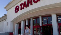 **FILE** An unidentified customer shops July 16, 2011, at a Target store in Los Angeles. (Associated Press)