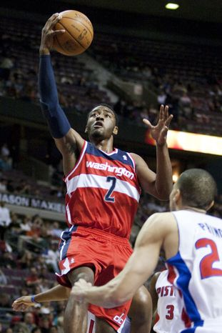 Washington Wizards' John Wall goes to the basket against Detroit Pistons' Tayshaun Prince in the first half of Thursday, April 5, 2012, in Auburn Hills, Mich. (AP Photo/Duane Burleson)