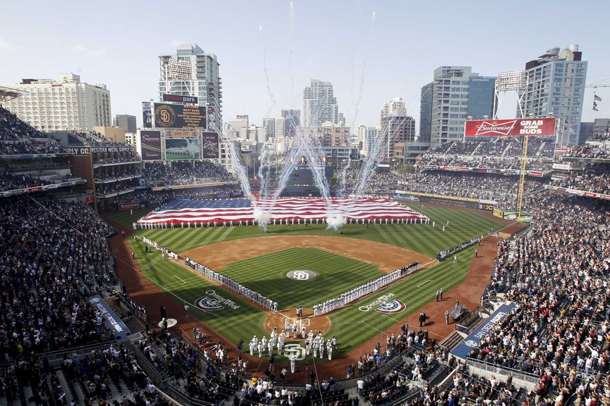 Players and spectators stand during opening day ceremonies at Petco Park for the baseball game between the San Diego Padres and the Los Angeles Dodgers, Thursday, April 5, 2012, in San Diego. (AP Photo/Lenny Ignelzi)