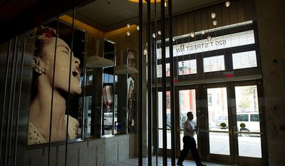 Ron Hazel, assistant project manager with Whiting-Turner construction walks through the lobby of the redesigned historic Howard Theatre is set to reopens with a ribbon cutting Monday and an opening night gala on Thursday, Washington, D.C., Thursday, April 5, 2012. (Andrew Harnik/The Washington Times)