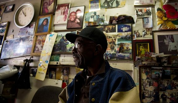 James Patterson, who has run a home improvement business next door to the Howard Theatre for 44 years and worked for the theatre from 1961 until it closed its doors sits in his office surrounded by photographs of friends and family, Washington, D.C., Thursday, April 5, 2012. The redesigned historic Howard Theatre is set to reopens with a ribbon cutting Monday and an opening night gala on Thursday. (Andrew Harnik/The Washington Times)