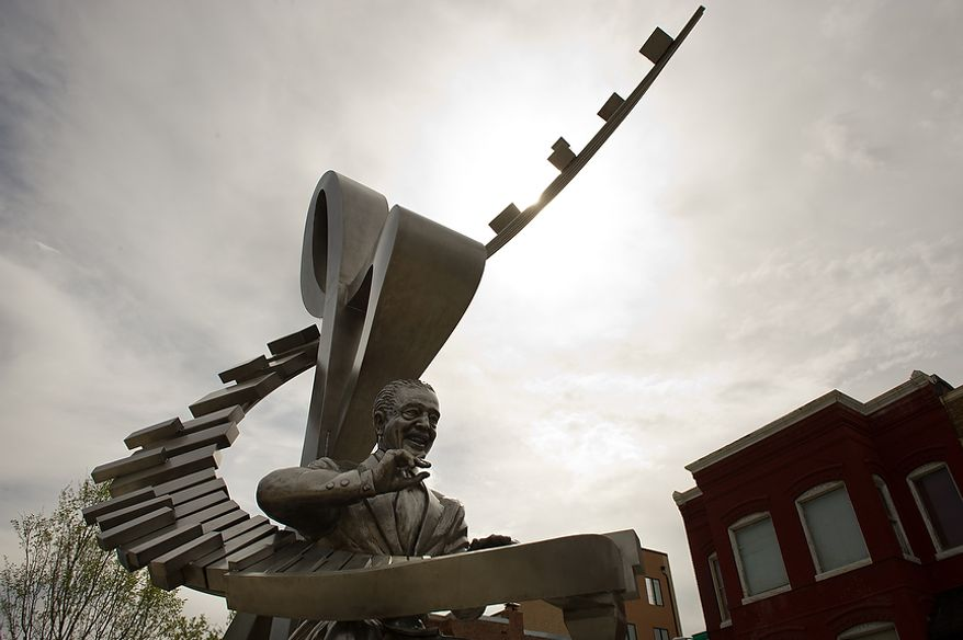 A newly installed stainless steel statue of D.C. native and jazz legend Duke Ellington sits in front of the redesigned historic Howard Theatre which is set to reopen with a ribbon cutting Monday and an opening night gala on Thursday, Washington, D.C., Thursday, April 5, 2012. (Andrew Harnik/The Washington Times)