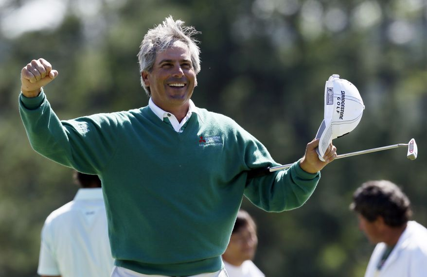 Fred Couples celebrates after finishing the second round the Masters tournament Friday, April 6, 2012, in Augusta, Ga. (AP Photo/David J. Phillip)