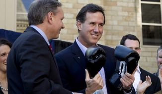 ** FILE ** In this April 4, 2012, file photo, Republican presidential candidate, former Pennsylvania Sen. Rick Santorum, center, holds a pair of boxing gloves at a campaign stop in Hollidaysburg, Pa. (AP Photo/Jae C. Hong, File)
