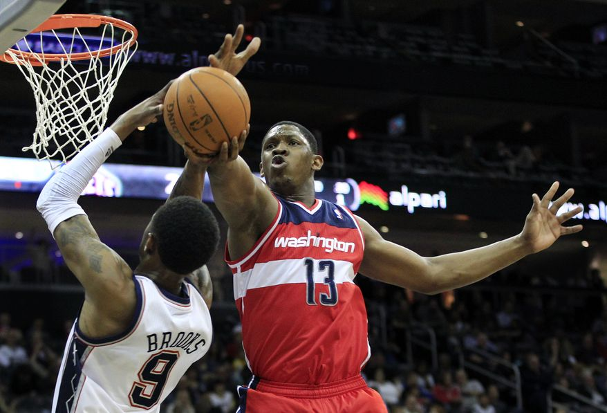 Washington Wizards' Kevin Seraphin blocks a shot by New Jersey Nets' Deron Williams during the first quarter in Newark, N.J., Friday, April 6, 2012. (AP Photo/Mel Evans)