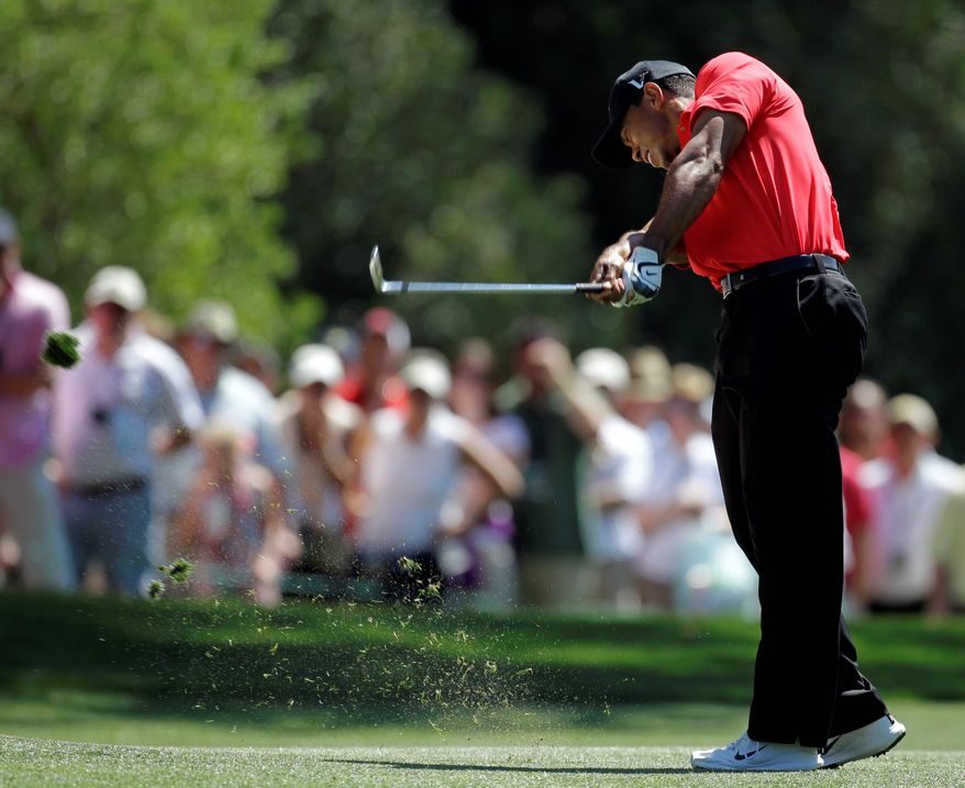 Tiger Woods hits off the first fairway during the fourth round of the Masters golf tournament Sunday, April 8, 2012, in Augusta, Ga. (AP Photo/Chris O'Meara)