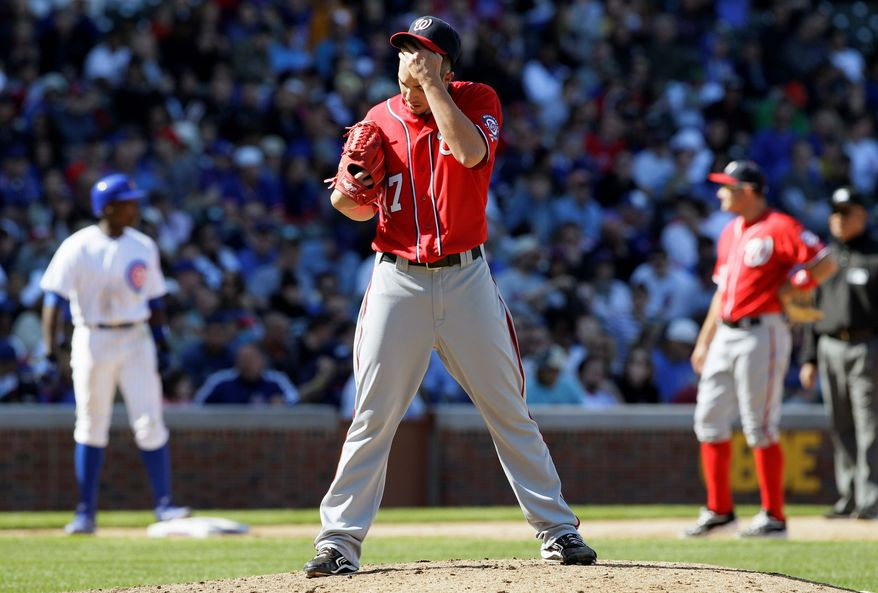 Washington Nationals relief pitcher Sean Burnett wipes his face during the eighth inning of a baseball game against the Chicago Cubs in Chicago, Sunday, April 8, 2012. The Cubs won 4-3. (AP Photo/Nam Y. Huh)