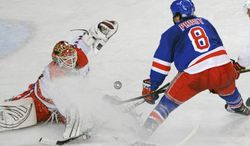 Washington Capitals goaltender Braden Holtby, left, makes a save on a shot by New York Rangers' Brandon Prust during the third period of an NHL game on Saturday, April 7, 2012 in New York. (AP Photo/Bill Kostroun)