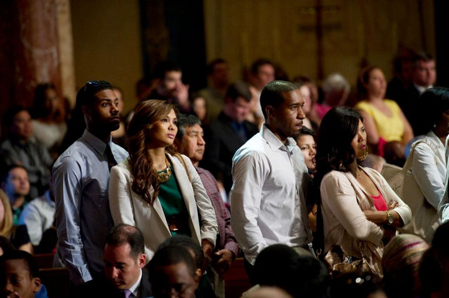 People in the aisles listen as Cardinal Donald Wuerl, Archbishop of Washington delivers his sermon during the Easter Sunday Solemn Mass at the Basilica of the National Shrine of the Immaculate Conception. (Rod Lamkey Jr/The Washington Times)