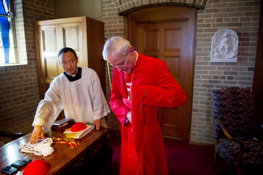 Cardinal Donald Wuerl, Archbishop of Washington is seen unvesting following the Easter Sunday Solemn Mass at the Basilica of the National Shrine of the Immaculate Conception. (Rod Lamkey Jr/The Washington Times)