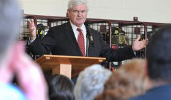 ** FILE ** Republican presidential candidate Newt Gingrich speaks at a public meeting at the Magnolia Volunteer Fire Company on Thursday, April 5, 2012, in Magnolia, Del. (AP Photo/Wilmington News-Journal, Gary Emeigh)