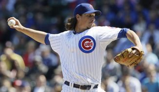Chicago Cubs starter Jeff Samardzija delivers a pitch during the second inning of a baseball game against the Washington Nationals in Chicago, Sunday, April 8, 2012. (AP Photo/Nam Y. Huh)
