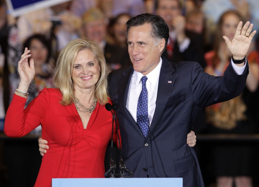 Republican presidential candidate Mitt Romney and his wife, Ann, wave as they leave at an election-night rally on Tuesday, March 20, 2012, after winning the Illinois primary. (AP Photo/Nam Y. Huh)