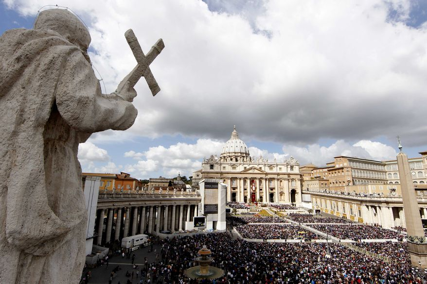Thousands of the faithful gather in St. Peter's Square at the Vatican for the Easter Mass celebrated by Pope Benedict XVI on Sunday, April 8, 2012. (AP Photo/Pier Paolo Cito)