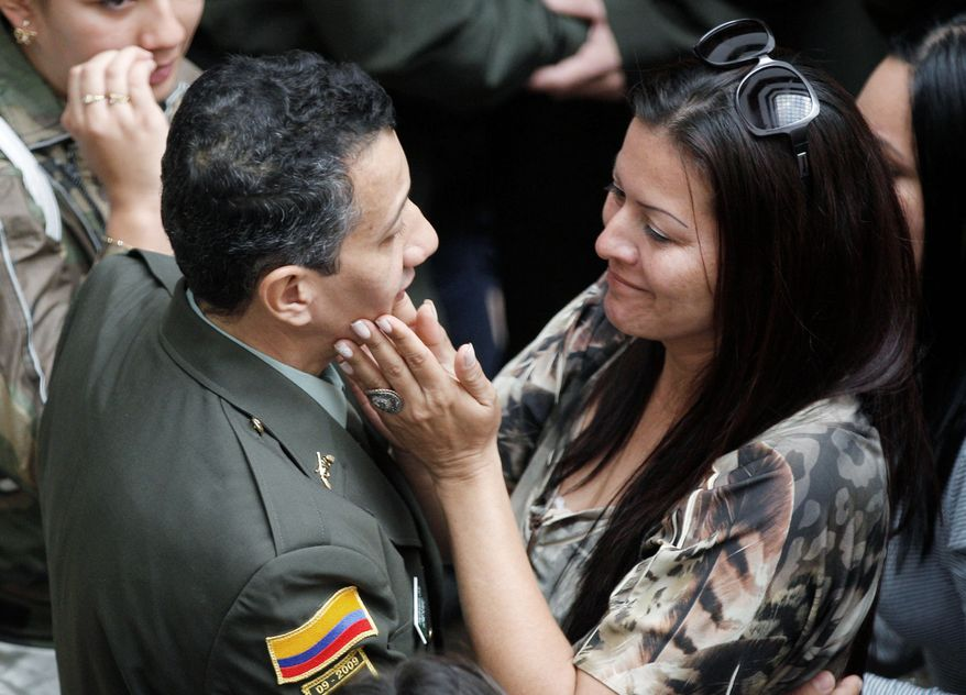 A relative embraces former hostage Jorge Romero at police headquarters in Bogota on April 4. Even if the FARC releases all its captives, many obstacles remain for talks aimed at ending a half-century of conflict in Colombia. (Associated Press)