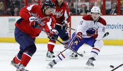 Capitals center Nicklas Backstrom (left) is rounding back into form after suffering a concussion. He'll be counted on to spark Washington's offense in the playoffs. (Associated Press)