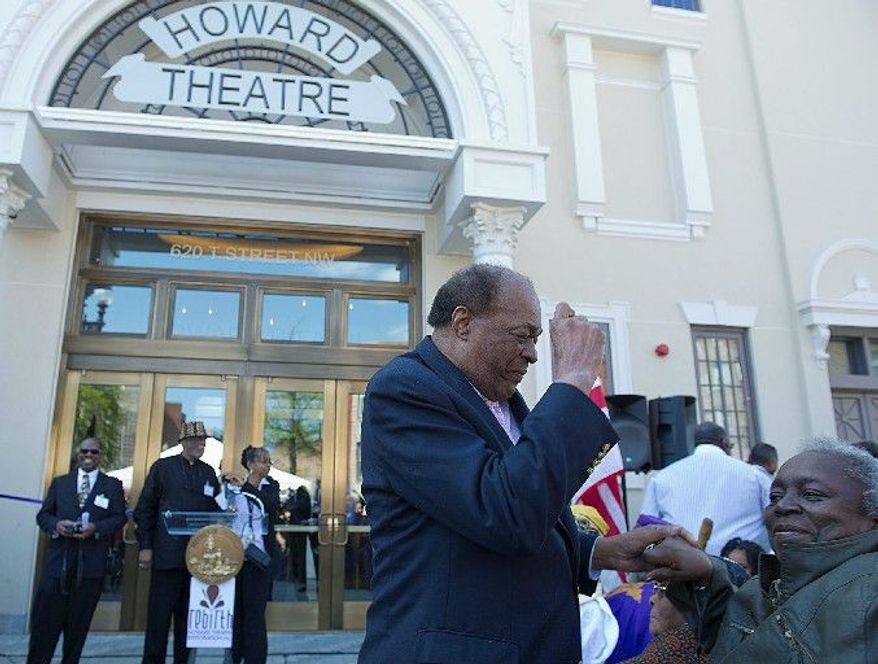 """D.C. Council member Marion Barry, the District's """"Mayor for Life, dances with Elizabeth Hicks at the opening celebration. Mr. Barry said he heard about the Howard before moving to Washington in 1965 and had to check it out. Ms. Hicks, who has lived in D.C. since the '70s, saw shows there all the time. (Barbara L. Sallisbury/The Washington Times)"""