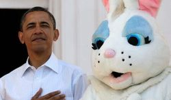 "President Obama and the Easter Bunny stand for the National Anthem to kick off Monday's annual Easter Egg Roll at the White House. The president shot some hoops, did push-ups and read an ""all-time classic"" book to some of the children. (Associated Press)"