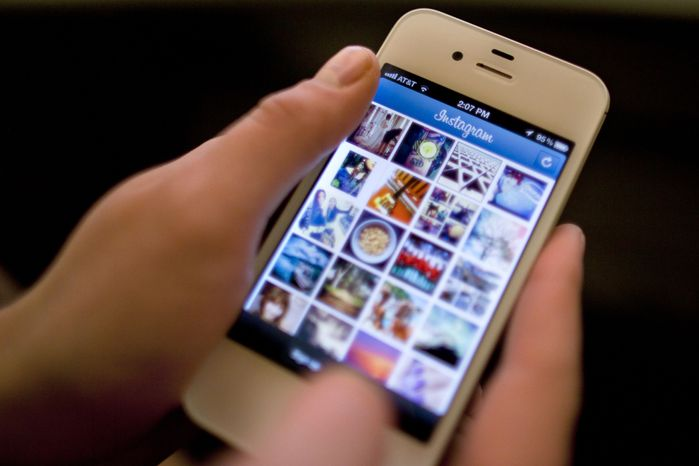 **FILE** Instagram is demonstrated on an iPhone on April 9, 2012, in New York. (Associated Press)