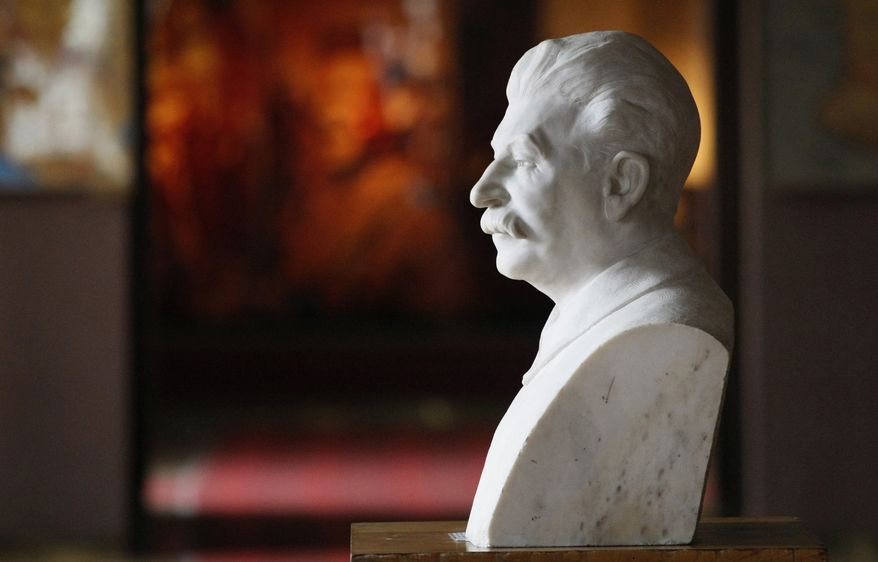 A bust of Soviet dictator Josef Stalin sits inside a museum dedicated to him in the town of Gori, some 50 miles west of the Georgian capital, Tbilisi, on Monday, April 9, 2012. The museum, which has honored Stalin since 1937, is being remodeled to exhibit the atrocities that were committed during his rule. (AP Photo/Shakh Aivazov)