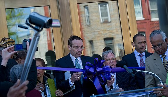 Mayor Vincent Gray and Councilman Jim Graham join others for the ribbon-cutting at the newly renovated Howard Theatre in Washington, D.C., on Monday, April 9, 2012. The theater, which originally opened in 1910, was one of the first places African-Americans could see live musical acts. The club promises to offer live acts again, this time with a full-scale kitchen and bar as well. (Barbara L. Salisbury/The Washington Times)