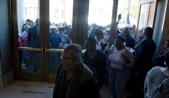 Crowds wait outside to come in and get a tour of the newly renovated Howard Theatre in Washington, D.C. on Monday, April 9, 2012. The theater, which originally opened in 1910, was one of the first places African-Americans could see live musical acts. Performers such as Duke Ellington, Chuck Berry, Marvin Gaye and Diana Ross all played here. (Barbara L. Salisbury/The Washington Times)