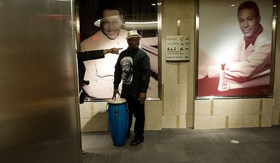JB Shoatz, a neighborhood commissioner in Ward 8, gets directions to the elevator in the newly opened Howard Theatre so that he can bring his conga drum up to the reception area, where he later played for guests touring the newly renovated space on Monday, April 9, 2012. (Barbara L. Salisbury/The Washington Times)