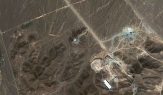 **FILE** A satellite image taken Sept. 27, 2009, shows a suspected nuclear enrichment facility under construction inside a mountain located north of Qom, Iran. (Associated Press/DigitalGlobe)