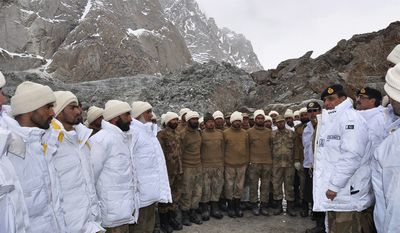 Gen. Ashfaq Parvez Kayani (second from right), Pakistan's army chief, talks to soldiers on Sunday, April 8, 2012, during a visit to the site of an avalanche that buried more than 120 soldiers in Siachen, Pakistan, on Saturday. (AP Photo/Pakistani Inter Services Public Relations)