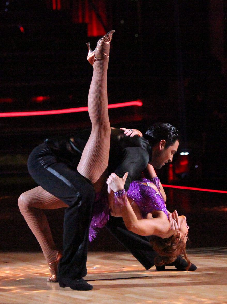 "In this April 2, 2012 photo released by ABC, actress Melissa Gilbert and her partner Maksim Chmerkovskiy perform on the celebrity dance competition series ""Dancing with the Stars,"" in Los Angeles. (AP Photo/ABC, Adam Taylor)"