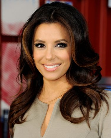 Actress Eva Longoria serves up the first sips of the new Pepsi Next in Times Square on Friday, April 6, 2012 in New York. (AP Photo/Evan Agostini)