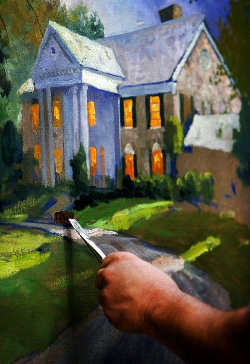 Thomas Kinkade works on a study of Elvis Presley's Graceland in Memphis, Tenn., in September 2006. Hand-signed limited-edition reproductions of his work sell for $8,000 to $15,000. (Associated Press)