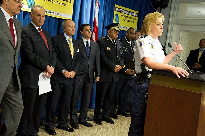 D.C. Police Chief Cathy L. Lanier and political and law enforcement leaders from several cities were present for the announcement Tuesday of the anti-smartphone theft initiative at the District's John A. Wilson Building. Attending were (from left) D.C. Mayor Vincent C. Gray, Sen. Charles Schumer, New York Democrat, New York Police Commissioner Raymond Kelly, FCC Chairman Julius Genachowski, Philadelphia Police Commissioner Charles H. Ramsey and Metro Transit Police Department Chief Michael Taborn. (Barbara L. Salisbury/The Washington Times)