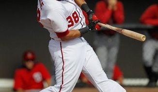 Michael Morse batted .303 with 31 home runs and 95 RBI for the Nationals in 2011, mostly as the first baseman. This year, he's slotted for left field. (Associated Press)