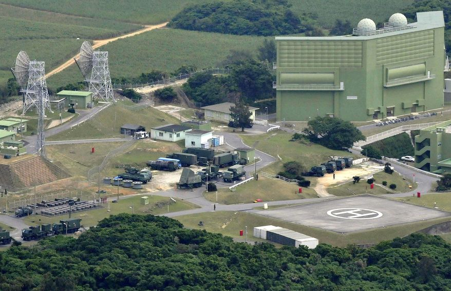 Patriot anti-missile batteries are set up in Okinawa, Japan, on Monday. The nation is preparing its reaction to a multistage rocket that North Korea plans to launch. (Kyodo News via Associated Press)