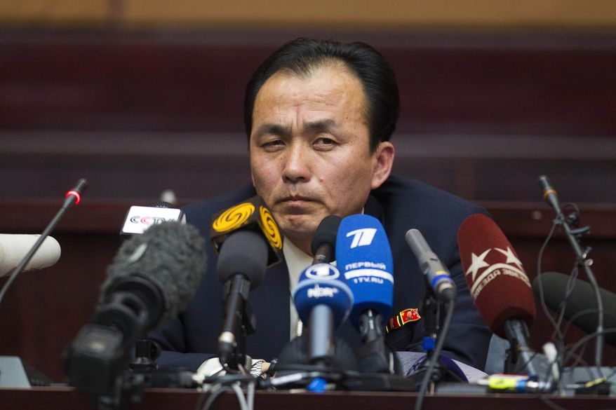 Ryu Kum-chol, deputy director of space exploration in the Department of Space Technology of North Korea, speaks to the international media in Pyongyang, North Korea, on Tuesday, April 10, 2012. (AP Photo/David Guttenfelder)