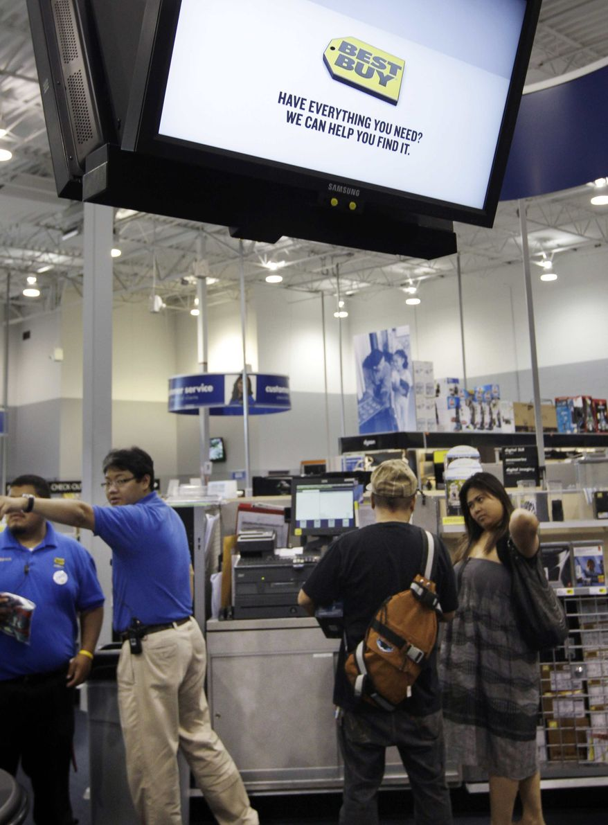 Best Buy workers help out customers at a Best Buy in Mountain View, Calif., Monday, Sept. 12, 2011. (AP Photo/Paul Sakuma)