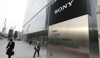 Employees leave the headquarters of Sony Corp. in Tokyo on Tuesday, April 10, 2012. (AP Photo/Koji Sasahara)