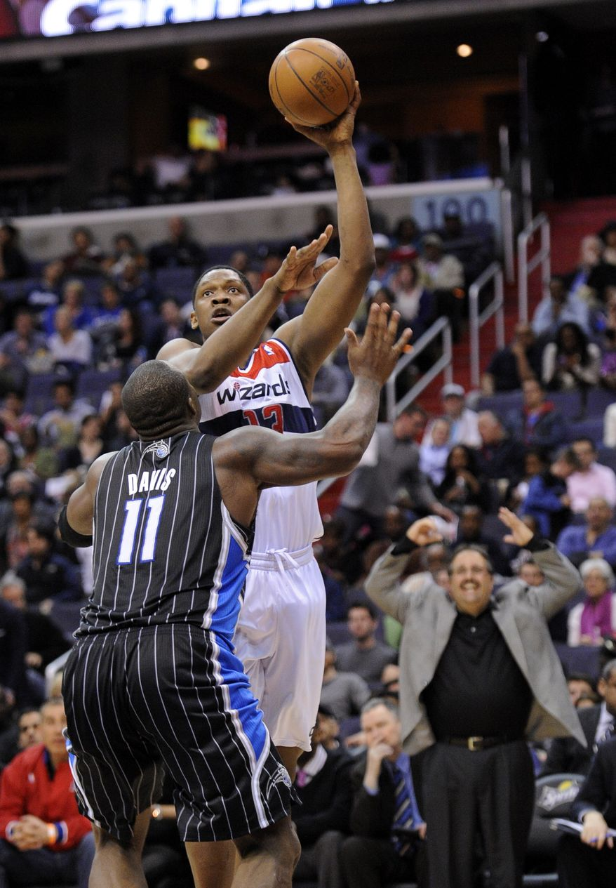 Washington Wizards forward Kevin Seraphin scored a career-high 24 points and had 13 rebounds as the Wizards defeated the Orlando Magic on Tuesday, April 10, 2012. (AP Photo/Nick Wass)