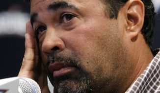 Miami Marlins manager Ozzie Guillen listens to a question during a news conference at the Marlins Stadium in Miami, Tuesday April 10, 2012. Guillen explained himself following favorable comments he made about Fidel Castro which infuriated many Cuban-Americans. Guillen has been suspended for five games effective immediately. (AP Photo/Lynne Sladky)